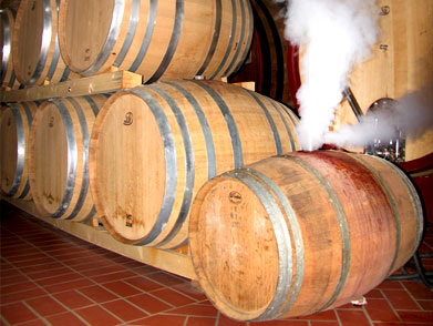 high temperature dry steam vapour discharges from the oak wine barrel, effectively removing contaminants, brettanomyces, and old wine from within the pores of the wood