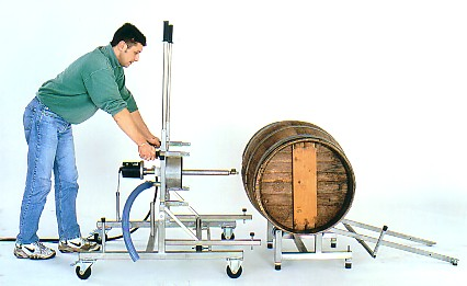 wine barrel prepared for loading onto manual trolley, prior to cleaning with high temperature steam vapour