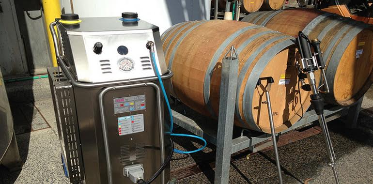wine barrel is filled with high temperature pressurised steam for effective sanitising